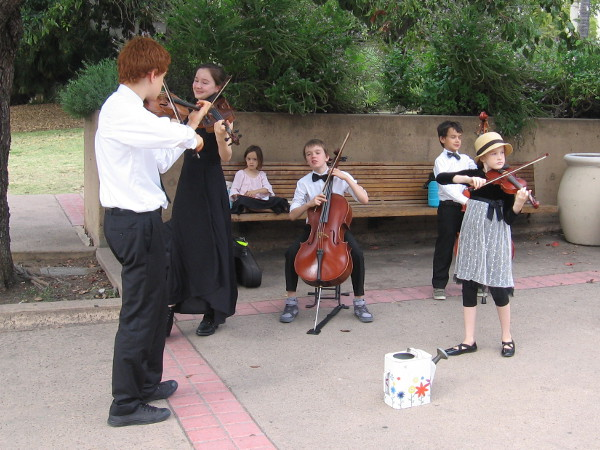 De la Motte Strings musicians perform in Balboa Park.