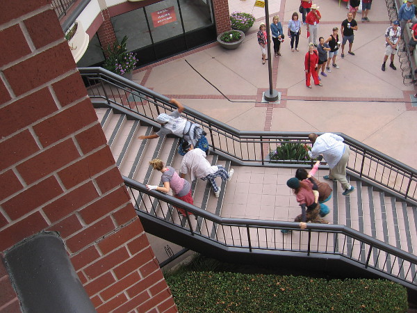 The dancers exit the stage by struggling up two sets of stairs at Hazard Center.