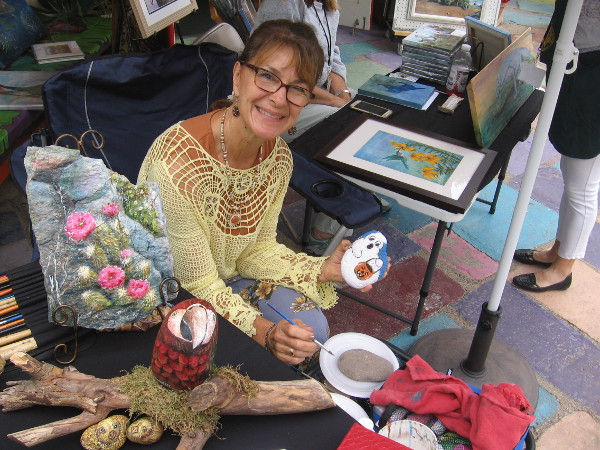 Karen, of the Southwestern Artists' Association in Spanish Village, was painting stones out on the patio!