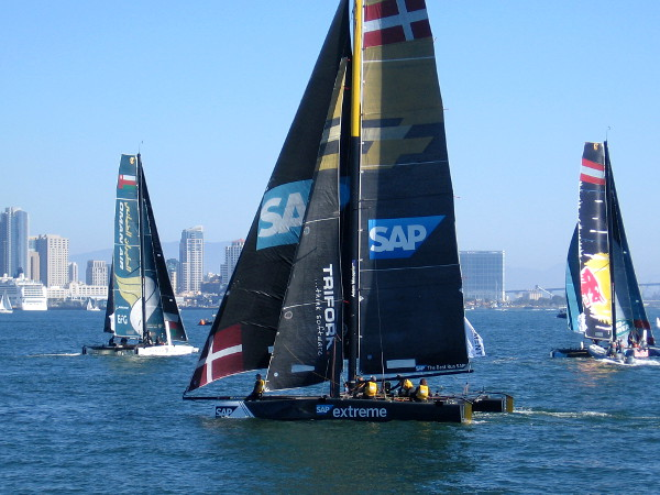 Hydro-foiling GC32 catamarans race across San Diego Bay during the 2018 Extreme Sailing Series.