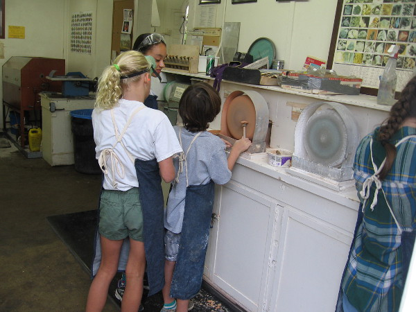 Artistic kids were using lapidary equipment inside the San Diego Mineral and Gem Society Museum.