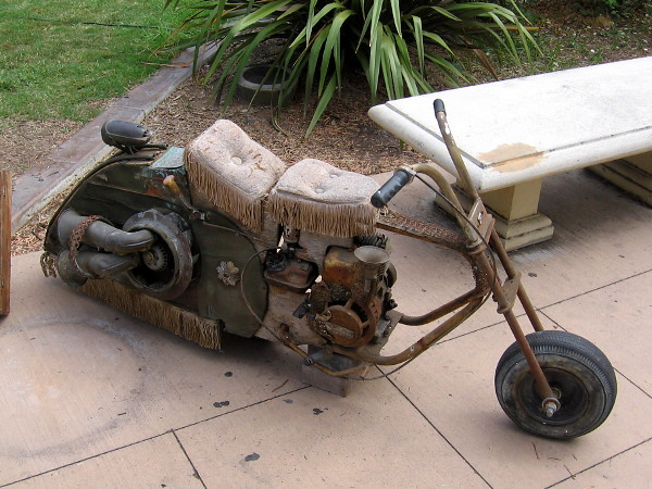 This cool minibike is made of odd objects, like a vegetable strainer, radio tuner, cereal bowl and umbrella. It's called the Time Machine.