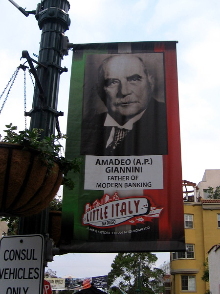 A streetlamp banner in San Diego's Little Italy pays tribute to Amadeo Giannini, father of modern banking.