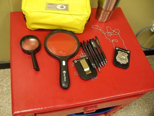 Some of the tools used by participants at Solve Who include forensic lights, magnifying lenses, string for trajectory pinpointing, and more.