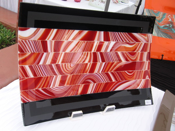 This photo and the next show kilnformed art glass produced by Rick Knight Designs. The tray is made of glass strips that are shifted and fused back together.