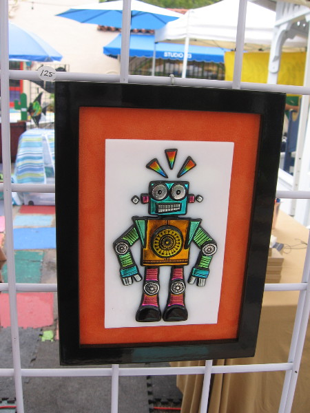 This cool glass robot and the next two photos show small bits of hand etched dichroic glasswear made by ChrisStell CreativeArts.