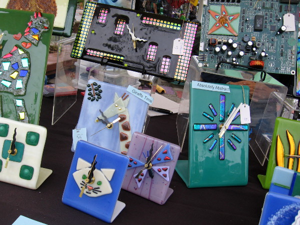 These clocks, some made with circuit boards from discarded computers, are the fused glass creations of The Glass Giraffe, Carol Korfin, artist.