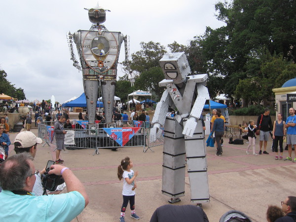A small human meets friendly Know Mann - Giant Robot Puppet!