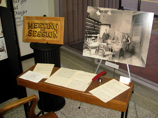 A display during Archives Month includes photograph of the City Clerk's office in San Diego, circa 1890.