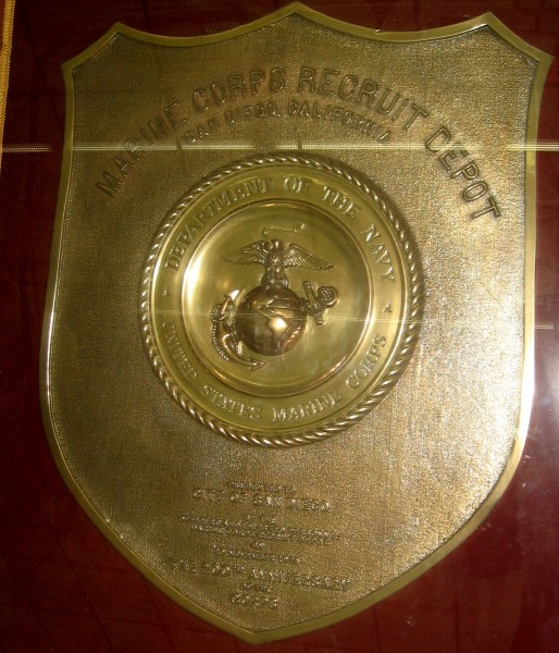 A closer photo of the shining brass plaque, which is on display inside the lobby of the San Diego City Administration Building.