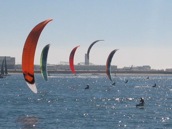 By sheer chance the racing kite boarders produce a beautiful photograph.