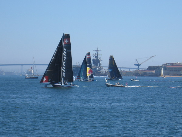 The super fast, hydro-foiling GC32 catamarans begin to maneuver before the first race begins. Seven teams would participate this weekend on San Diego Bay.