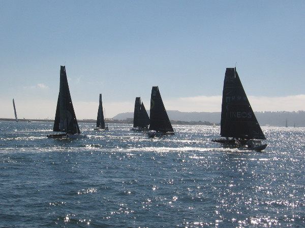 The fast catamarans maneuver up the course into the sun. The wind was a bit disappointing today due to the mild Santa Ana-like weather this weekend.