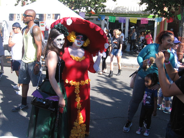 Many costumes celebrating Día de los Muertos (and also Halloween) could be seen about the fun North Park festival.