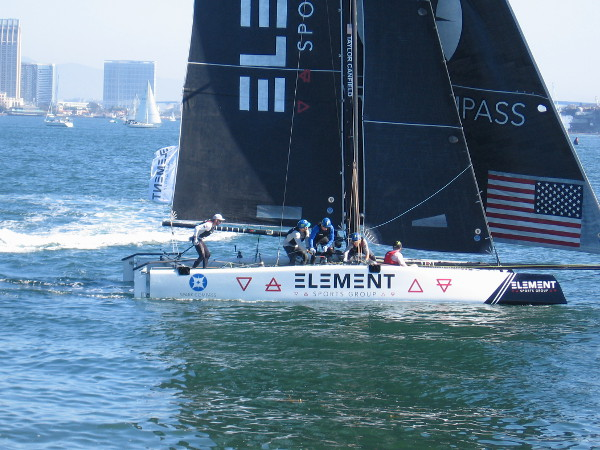 Here comes the Element Spark Compass catamaran! The crew works hard to capture every inch of wind.
