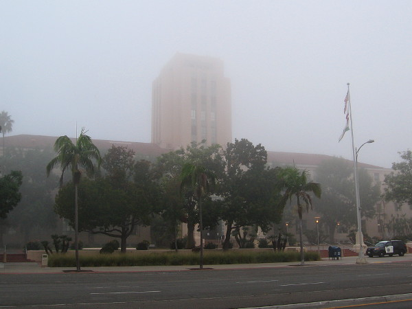 San Diego's distinctive County Administration Building appears ghostly in a morning fog.