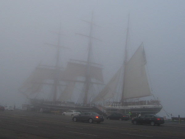 The historic tall ship Star of India appears through the fog on San Diego's Embarcadero.