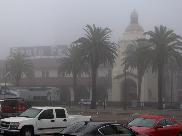 The iconic Santa Fe Depot in the fog, seen from the west.