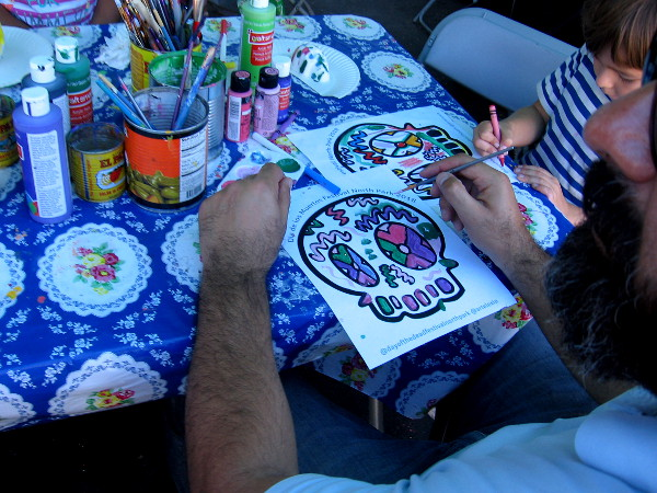 Kids and adults could color a calavera, or decorative skull.