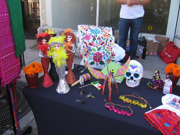 Some Día de los Muertos items for sale included Catrina dolls, orange marigolds and colorful calaveras.