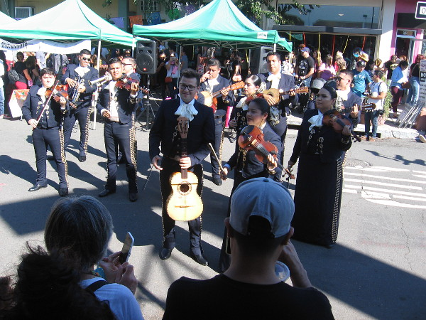 Mariachis performed joyful music for the crowd at one end of the city block.