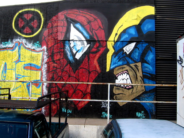 Spiderman faces off against a member of the X-Men in street art in Logan Heights.