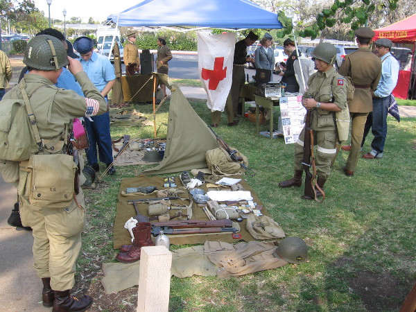 Members of the reenactment group displayed artifacts from past wars, and wore military uniforms.