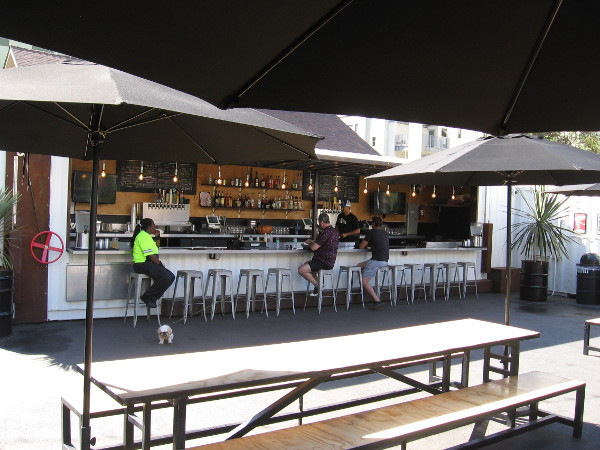 In addition to Burgers and Bites by a small event stage, Quartyard features benches and this outdoor bar.