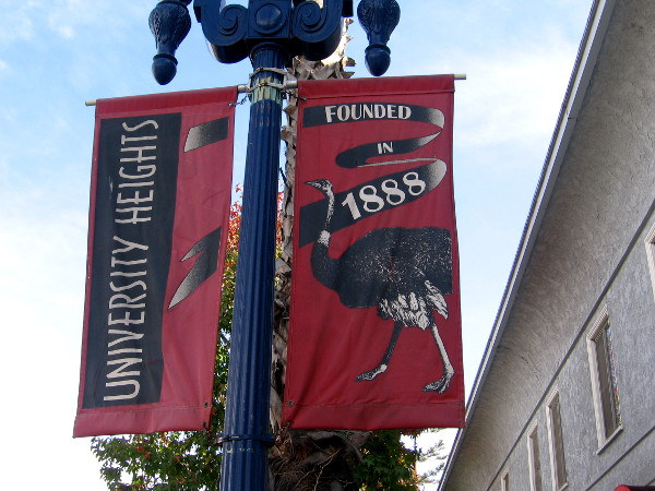 Street lamp banner with ostrich proclaims University Heights - Founded in 1888.