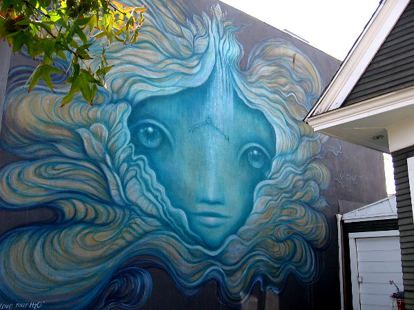 Love Your H2O, a mural painted by local artist Gloria Muriel for the Sea Walls: Murals for Oceans project.