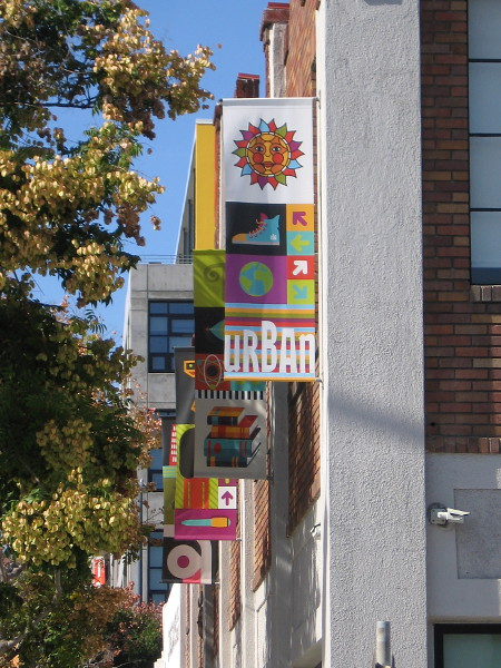 Colorful banners along the side of Urban Discovery Academy in East Village.