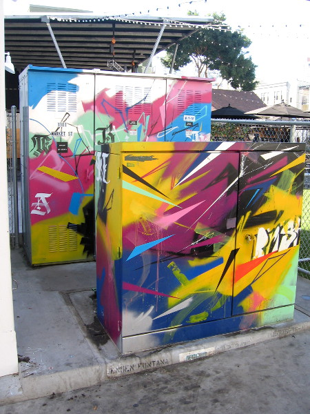 Colorfully painted utility boxes just outside Quartyard.