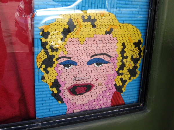 An artistic blonde peers out from a shop window in East Village!