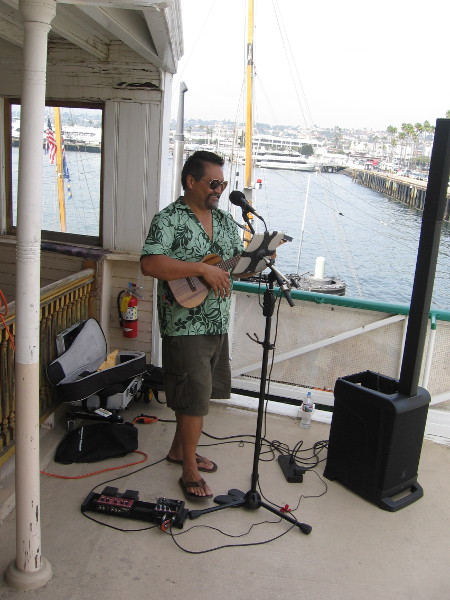 This cool dude up on the passenger deck of the Berkeley was playing mellow island music.