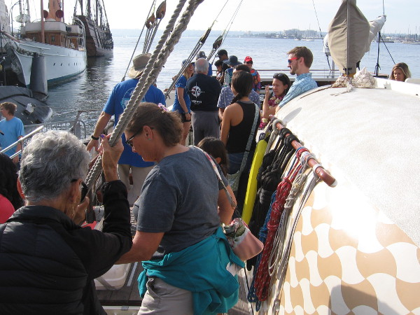 Lots of curious visitors were walking about the wooden deck of the Polynesian canoe.