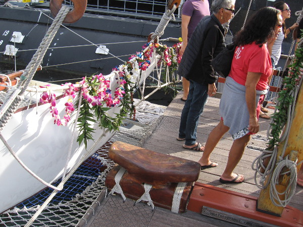 Garlands of tropical flowers decorate the bow of Hikianalia.