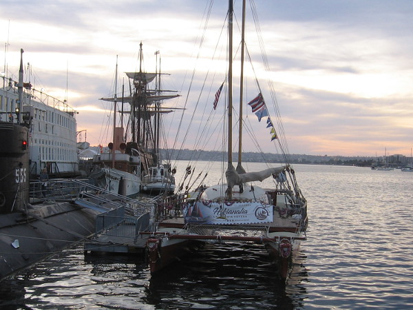 Hikianalia docked near several historic vessels of the Maritime Museum of San Diego.