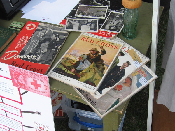 Ephemera on display include old issues of The Red Cross Magazine.