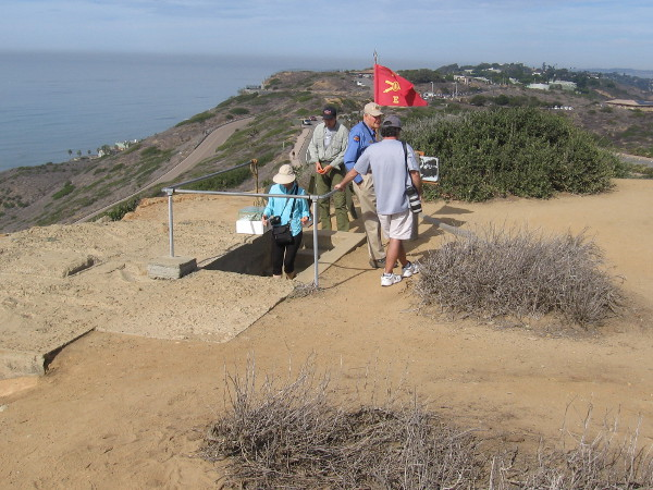 Visitors to Cabrillo National Monument enter the restored Base End Station and Battery Commander's bunker north of the Old Point Loma Lighthouse. Battery Ashburn can be seen in the distance.
