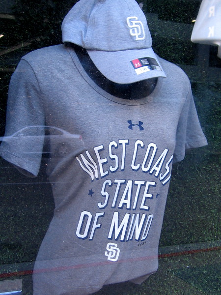 A new shirt with a West Coast State of Mind, in a window of the Padres Team Store in the old Western Metal Supply Building.