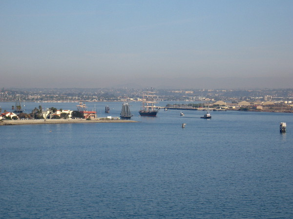 Star of India is towed past Naval Base Point Loma as it heads out of San Diego's harbor toward the open ocean.