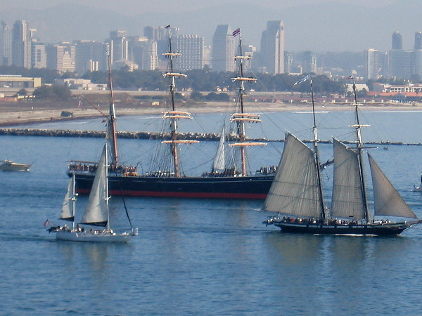 Two beautiful tall ships of the Maritime Museum of San Diego, Star of India and Californian, head out into the Pacific Ocean.