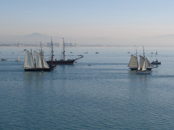 The beautiful tall ships continue past Point Loma, making their way south.