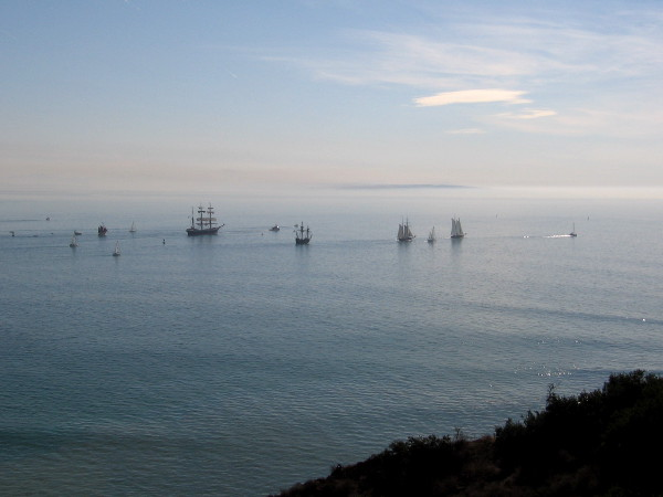 A magical vision of historic tall ships seen from the end of Point Loma. Time's curtain seems to open, and we peer into the past.