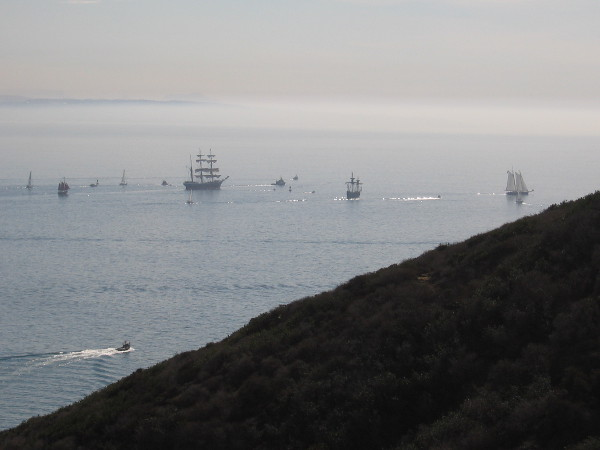 The ships sail past the end of Point Loma. My old camera can barely photograph them at this distance.