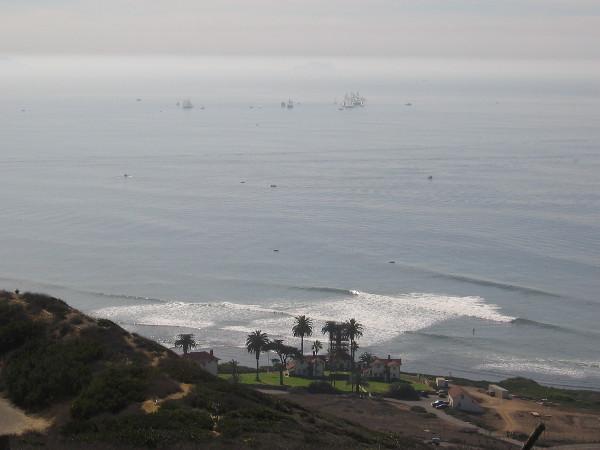 Ships melt into the hazy distance.