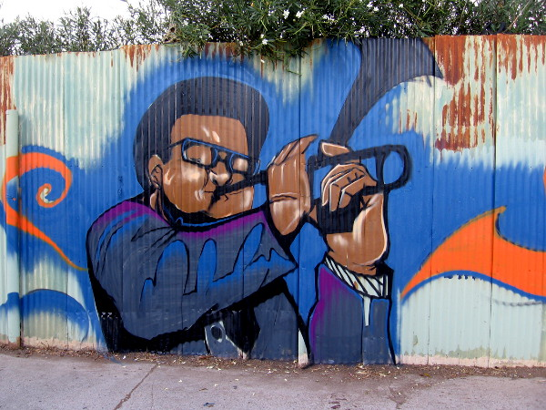 A neighbor in Logan Heights loves old school Jazz, so Fizix included this cool musician in the large mural.