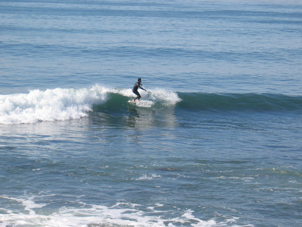 A lone surfer has caught a good wave!