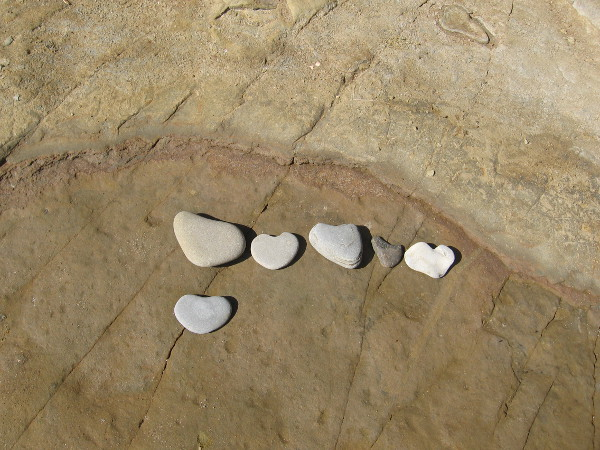 Someone--a young person most likely--searched for heart-shaped stones on the rocky beach and lined them up for all to see.
