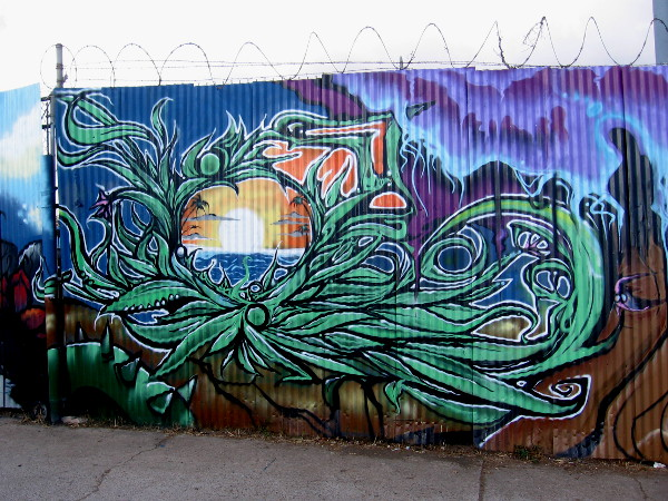 This very awesome sunset portion of the mural is by the artist ABSO. It looks like street art one might find in Ocean Beach.